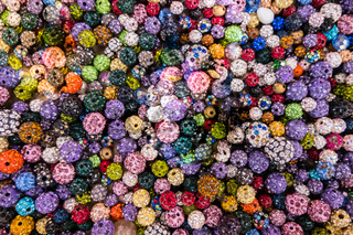 Colorful sparkling balls of jewelery beads.