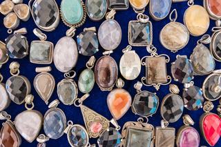 Vintage pendant with colorful diamond shape stones.