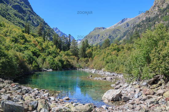 Closeup view of lake scenes in mountains, national park Dombay, Caucasus