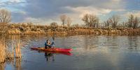 kayak paddling on lake in early spring