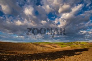 Flying clouds over landscape