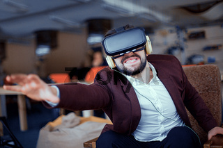 Adult bearded man wearing virtual reality vr glasses