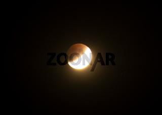 Lunar eclipse on black background