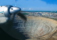 The view from the window of a passenger plane during the flight over the mine