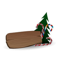 Festive composition with Christmas tree, sweets and the wooden board on a white background.