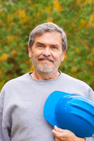 Contractor Builder with blue hardhat
