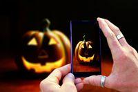 Shooting halloween pumpkin with mobile phone