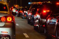cars in traffic jam at night