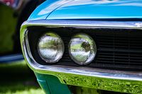 Old American muscle car half front side