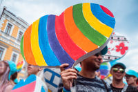 People carry lgbt hearts at the LGBT parade