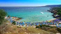 People at the famous beach of Konnos Bay Beach, Ayia Napa. Famagusta District, Cyprus. Best beaches of Cyprus - Konnos Bay in Cape Greko national park