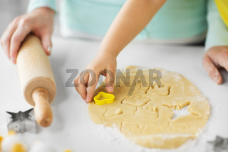 mother and daughter making cookies at home
