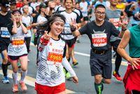 Young woman running at the Chengdu marathon