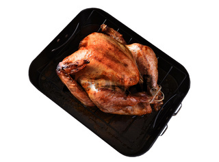 High angle view of a cooked Thanksgiving Turkey in a roasting pan isolated on white.
