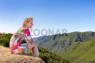 Dutch woman sitting in mountain landscape