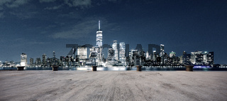 empty ground with modern cityscape new york at night