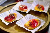 Grilled oscypek serving on white plates