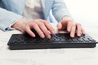 Business woman using computer keyboard