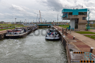 Lock in Dutch canal Gent - Terneuzen with passing cargo ships