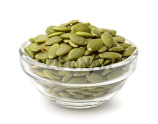 Glass bowl of pumpkin seeds