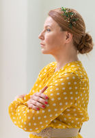 Portrait of a Beautiful Red-haired Woman in a Yellow Dress