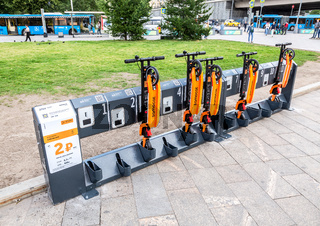 Parking of rental kick scooter at the city street