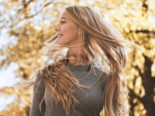 blond teenage girl flicking her hair