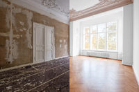 renovation concept - room in apartment before and after renovation works.  plastered and painted walls, white doors and wooden oak parquet floor -