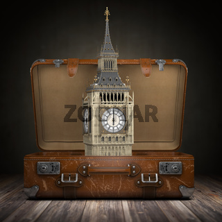 Trip to London. Travel or tourism to England or Great Britain concept. Big Ben tower in the open vintage suitcase.