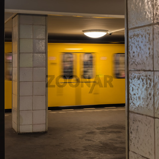 The old yellow berlin subway enters the subway station