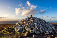 Sunset at Ticknock hill in Wicklow mountains with pile of stones, golden hour, Ireland