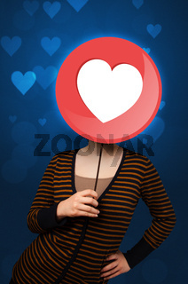 Woman holding heart sign