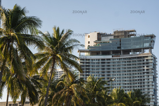 NHA TRANG, VIETNAM - JANUARY 25, 2019. Scenic summer view of the modern architecture with business skyscrapers, hotels and apartment buildings with a palm trees.