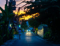Small street in Seminyak at sunset, in Bali, Indonesia