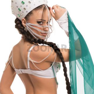 Sexy brunette in kokoshnik and white lingerie