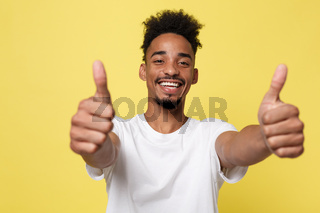 Happy African-American Businessman isolated on yellow background.