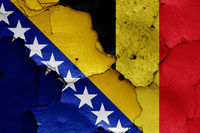 flags of Bosnia and Herzegovina and Belgium painted on cracked wall
