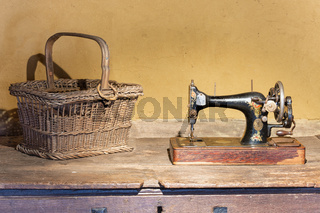 Dutch agricultural museum with reed basket and Singer sewing machine