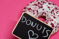 Macro shoot of donut on pink