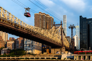 New York City / USA - JUL 31 2018: Queensboro Bridge and  Roosevelt Island Tramway at sunrise