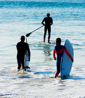 Group surfers going  surf SIlhouette.