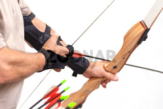 Archer close up, preparing the arrow for the shot, on white isolated background.