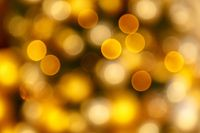 abstract blurred of gold glittering shine bulbs lights background:blur of Christmas wallpaper decorations concept. Xmas holiday festival backdrop sparkle circle lit celebrations display