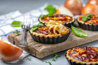 Delicious homemade mini pies with onions.