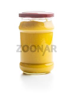 Yellow mustard in jar.