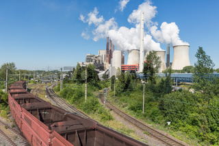 German Coal-fired power plant with empty cargo train near Garzweiler mine