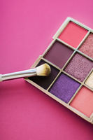 Eyeshadow palette and make-up brush on rose background, eye shadows cosmetics product for luxury beauty brand promotion and holiday fashion blog design