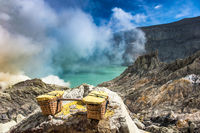Baskets of sulfur at Kawah Ijen volcano, Java, Indonesia
