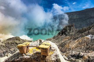 Baskets of sulfur at Kawah Ijen volcano, Java, Indonesia