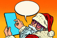 Santa Claus with a tablet. merry Christmas and happy new year